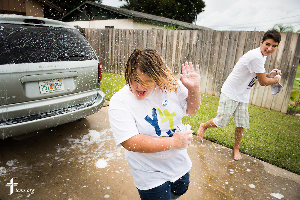 Y4Life student volunteers Rachael Mathis and Eli Gill take a lighthearted moment while they wash the house van at Redeeming Life Maternity Home during a Y4Life servant event on Saturday, Sept. 12, 2015, in Sanford, Fla. LCMS Communications/Erik M. Lunsford