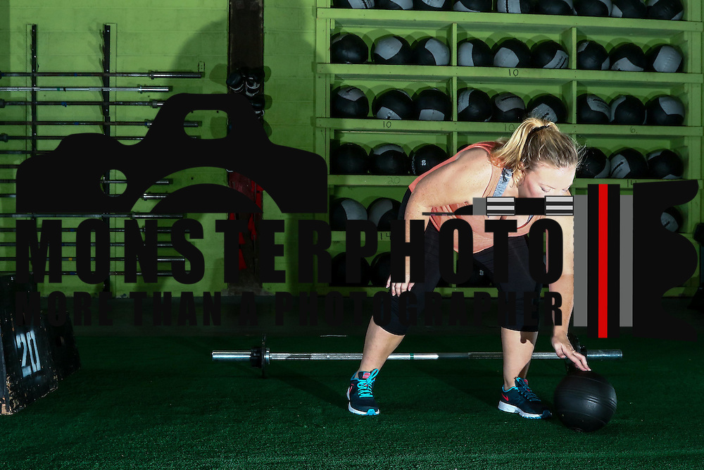 Katie Hemming who is 6 and a half months pregnant prepares to use a medicine ball during a CrossFit class Thursday, August 18, 2016, at CrossFit Riverfront in Wilmington.