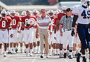 PALO ALTO, CA -  OCTOBER 17:  Head coach Bill Walsh of Stanford University leads the team onto the field before an NCAA football game against the Arizona Wildcats played on October 17, 1992 at Stanford Stadium in Palo Alto, California. Future Stanford Head Coach David Shaw (holding helmet) is visibile behind Shaw.  Photograph by David Madison (www.davidmadison.com)