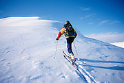 Alaska. Talkeetna Mts. Hatchers Pass. Backcountry skiing. Breaking trail towards Bald Mtn Ridge (4500 ft).