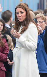 PORTSMOUTH- UK- 12-FEB-2015- Catherine HRH The Duchess of Cambridge visits the site of Ben Ainslie Racing and the 1851 Trust HQ. <br /> The Duchess of Cambridge and Sir Ben Ainslie view an art project at the construction site of the new headquarters and Visitor Centre.  Her Royal Highness will meet local street artists James Waterfield and My Dog Sighs and students from six local schools who created the mural, which depicts the skyline from Portsmouth to Ryde, Isle of Wight, and the Solent waters filled with images of its rich maritime history. Her Royal Highness will add her own detail to the mural.<br /> Photograph by Ian Jones