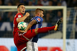 GELSENKIRCHEN, Sept. 20, 2017  Guido Burgstaller of Schalke 04 vies for the ball with Niklas Suele (L) of Bayern Munich during their German Bundesliga match in Gelsenkirchen, Germany, on Sept. 19, 2017. Bayern Munich won 3-0. (Credit Image: © Joachim Bywaletz/Xinhua via ZUMA Wire)