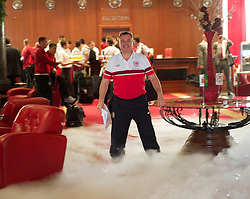 NOVI SAD, SERBIA - Monday, September 10, 2012: Cliff Evans walks through dry ice and bubbles as the Hotel Park welcomes the players to Novi Sad ahead of the 2014 FIFA World Cup Brazil Qualifying Group A match against Serbia. (Pic by David Rawcliffe/Propaganda)