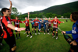 Dejan Milic (R), Alen Coralic (L), Jaka Ihbeisheh (11) of Primorje celebrate after the football match between NK Primorje Ajdovscina and NK Triglav Gorenjska of Second Slovenian football league, on May 16, 2010 in Vipava, Slovenia. Primorje placed first in 2.SNL and qualified for  PrvaLiga in season 2010/2011. (Photo by Urban Urbanc / Sportida)
