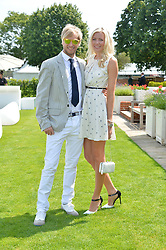 RICK PARFITT JNR and RACHEL GRETTON at the Audi International Polo at Guards Polo Club, Windsor Great Park, Egham, Surrey on 26th July 2014.