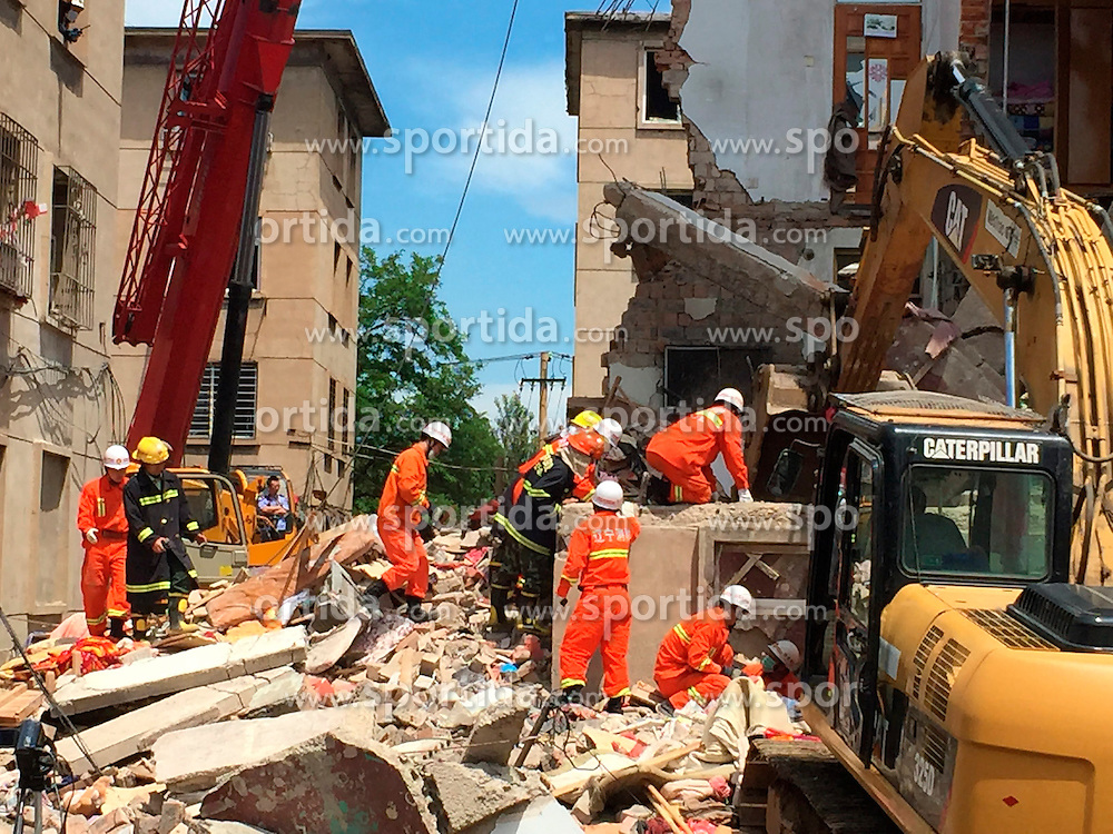 Rescuers work at the accident scene where an explosion took place in Huludao City, northeast China's Liaoning Province, June 12, 2015. At least 10 people were injured after an explosion ripped through a residential building on Friday morning in Huludao, said local authorities. The authorities said it was a suspected liquified gas explosion. EXPA Pictures &copy; 2015, PhotoCredit: EXPA/ Photoshot/ xinhua<br /> <br /> *****ATTENTION - for AUT, SLO, CRO, SRB, BIH, MAZ only*****