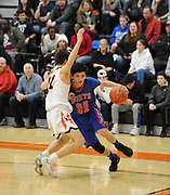 Newton South sophomore Max Aicardi drives past Newton North junior Thomas Andreae  during the game at Newton North, Dec. 27, 2018.   [Wicked Local Photo/James Jesson]