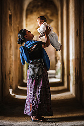 Young mother and child in native dress, Antigua, Guatemala. Model Released.