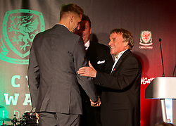 CARDIFF, WALES - Monday, October 2, 2017: Wales' David Edwards is presented with the Media Choice Player of the Year Award by BBC Radio Wales' Rob Phillips during the FAW Awards Dinner at the Hensol Castle. (Pic by David Rawcliffe/Propaganda)