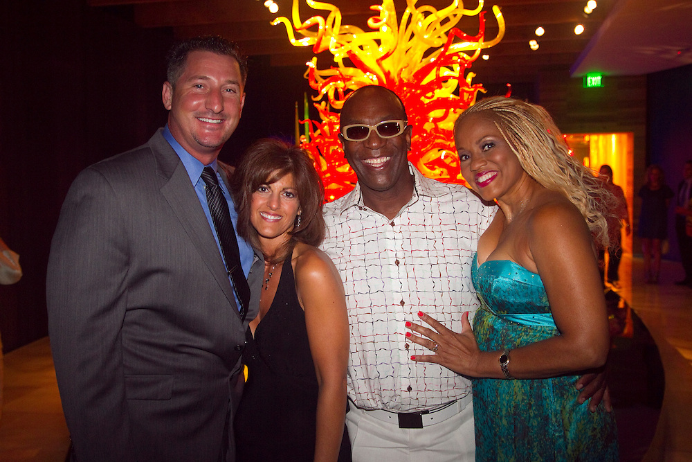 BAY_CarnivaleOfGlass..Caption:(Saturday 07/10/2010 St. Petersburg)Nick and Connie Fusella with Commodores founder Thomas McClary and his wife Beryl McClary..Summary:Morean Arts Center Carnivale of Glass..Photo by James Branaman