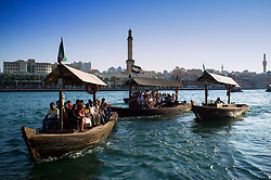 Traditional Abra water ferries crossing The Creek at Deira in Dubai United Arab Emirates