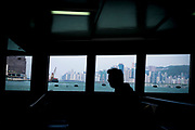 Hong Kong, China - Man on the ferry that travels across Victoria Harbour from Kwun Tong on the Kowloon side to North Point on the Hong Kong side on May 03, 2018.