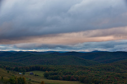 A fading sun and heavy clouds combine for a subdued, colorful display in Randolph County, West Virginia.