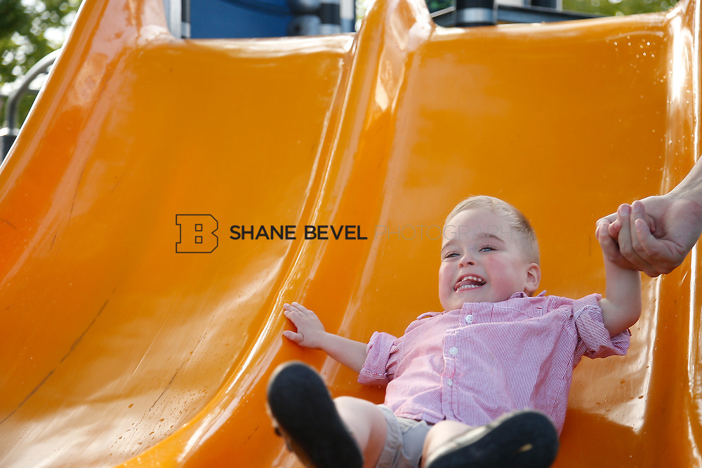 5/28/15 6:05:33 PM -- Miracle Miles and his family pose for portraits and play at the QuikTrip park for the 2015 Saint Francis Health System advertising campaign. <br /> <br /> Photo by Shane Bevel