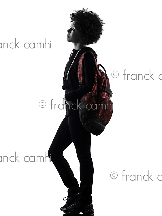 one mixed race african young teenager girl woman standing looking up  in studio shadow silhouette isolated on white background