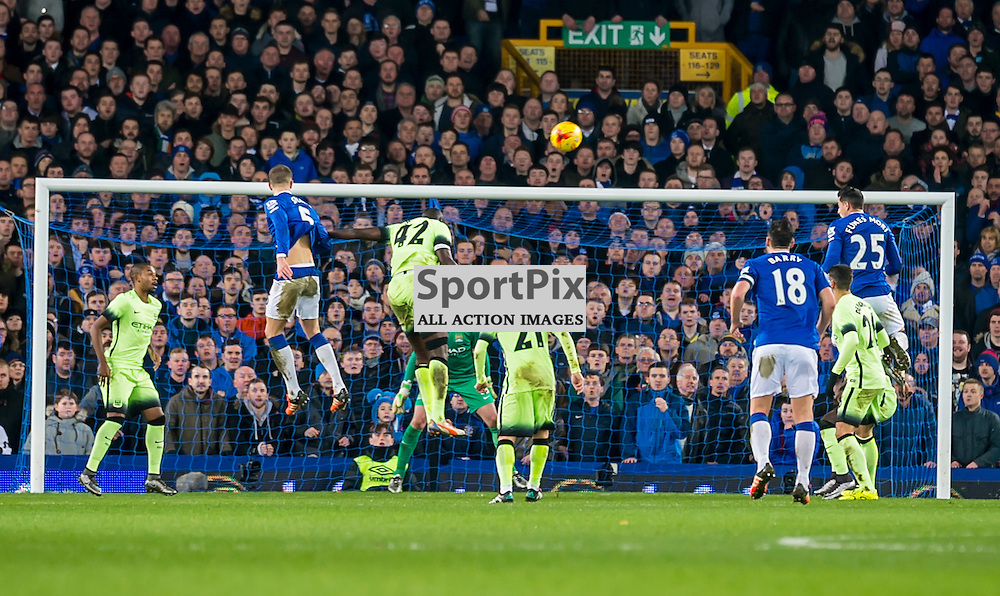 Everton defender John Stones heads over the crossbar in the Football League cup semi-final first leg at Goodison Park, Liverpool