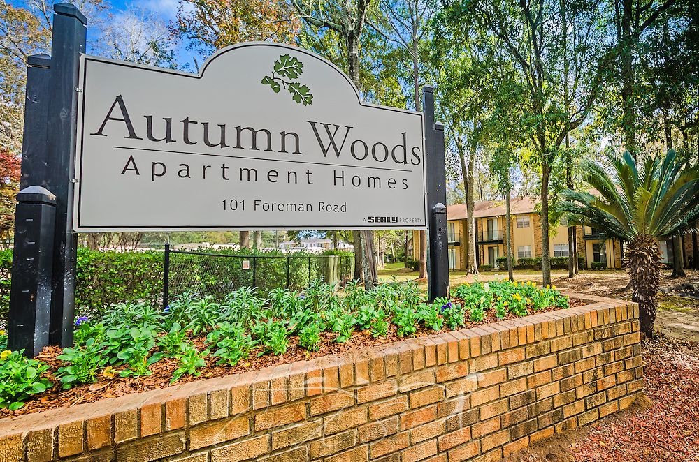 An entrance sign welcomes residents to Autumn Woods apartment homes in Mobile, Alabama. The apartment complex, located on Foreman Road, is owned by Sealy Management Company. (Photo by Carmen K. Sisson/Cloudybright)