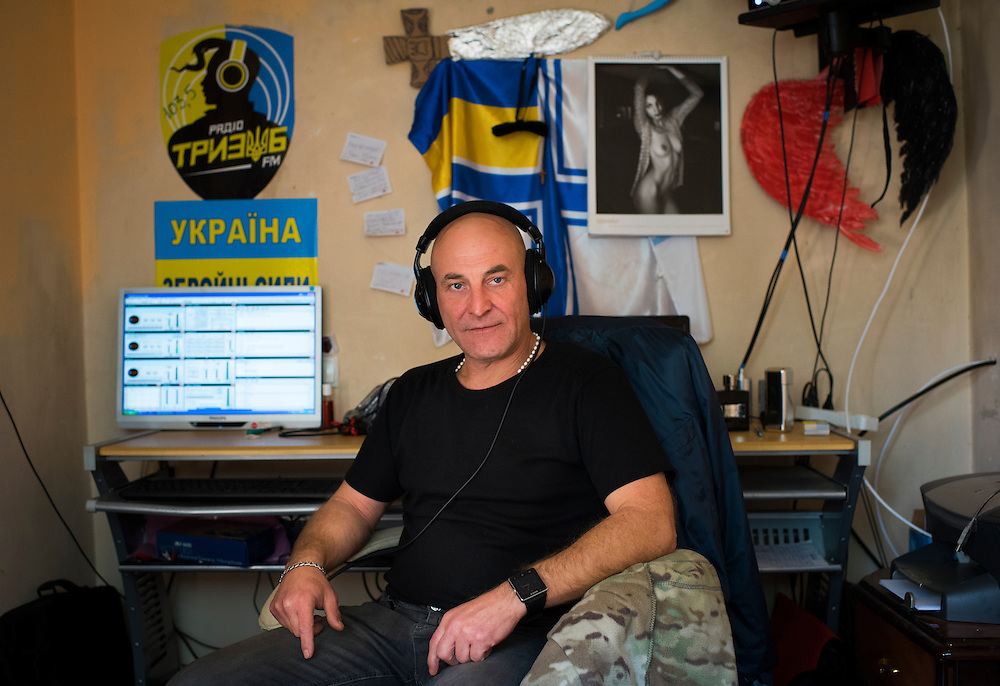 [Note: photo contains nudity] Ukrop Dental founder Igor Yaschenko poses for a portrait inside his bedroom, which also serves as the studio for Trizub Radio, at the clinic on September 23, 2016 in Karlivka, Ukraine about 12km from the front line.