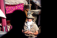 FAIZABAD, 30/07/05..Woman soldier on the road