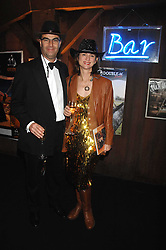 VISCOUNT & VISCOUNTESS MACKINTOSH OF HALIFAX at the London Red Cross Ball themed 'Honky Tonk Blues' held at 99 Upper Ground, London SE1 on 21st November 2007.<br />