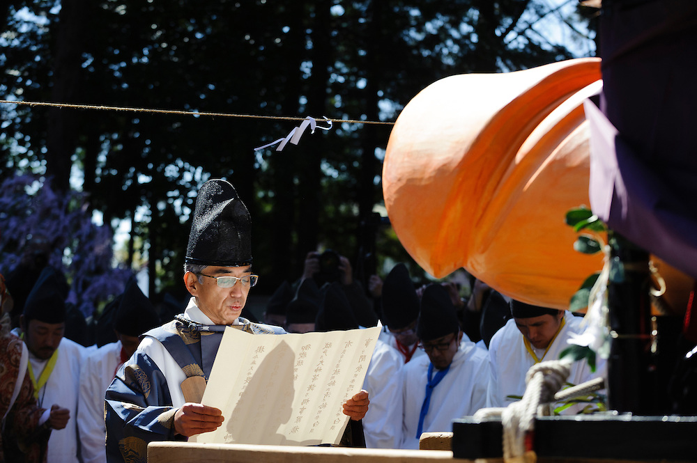 A Shinto priest performs a ceremony before a wooden phallus during Honen-sai, a fertility festival at Tagata Shrine in Komaki, Aichi Prefecture, Japan. The traditional Shinto festival celebrates fertility and a bountiful harvest. The principal offering during the festival is a large wooden phallus. Each year a craftsman carves a new phallus from a Japanese cypress tree. It measures almost 2.4 meters (13 feet) long and weights 280kg (620 pounds).