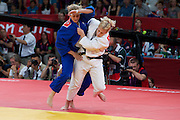 Kayla Harrison, USA, throwing Gemma Gibbons, GBR, on her way to the USA's first Olympic gold medal in judo. London 2012