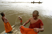 Sekong River, Cambodia-- Aug, 18 2004       Young budhist monks bathe at the Sekong River, a tributary of the Mekong. photo by essdras m suarez/globe staff     Library Tag 11282004   Travel      -  CROSSING DIVIDES