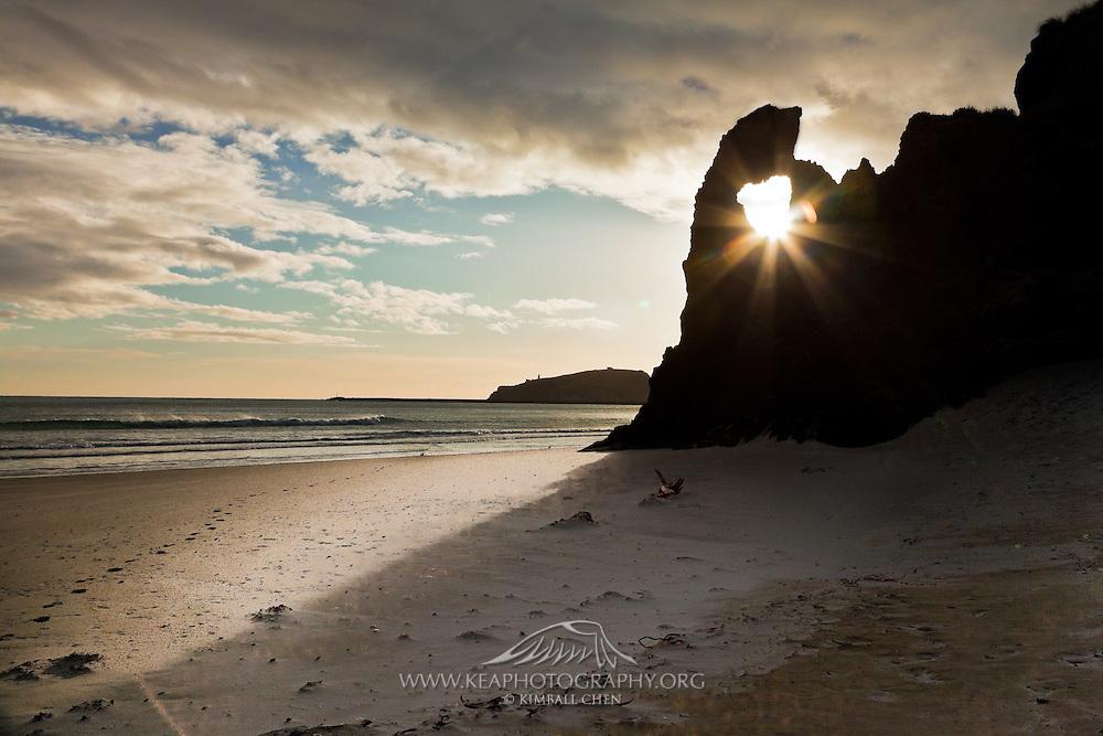 Sunburst through Keyhole Rock, Aramoana, New Zealand