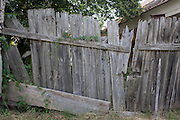 Broken fencing of abandoned home and land in the village of Bakonygyirot, Gyor-Moson-Sopron, Hungary