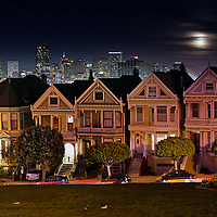 Moonrise over Victorian houses on Alamo Square, San Francisco, California.
