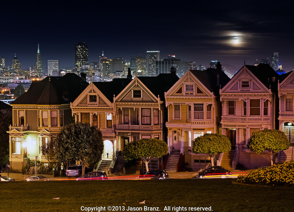 Moonrise over Victorian houses on Alamo Square, San Francisco, California.