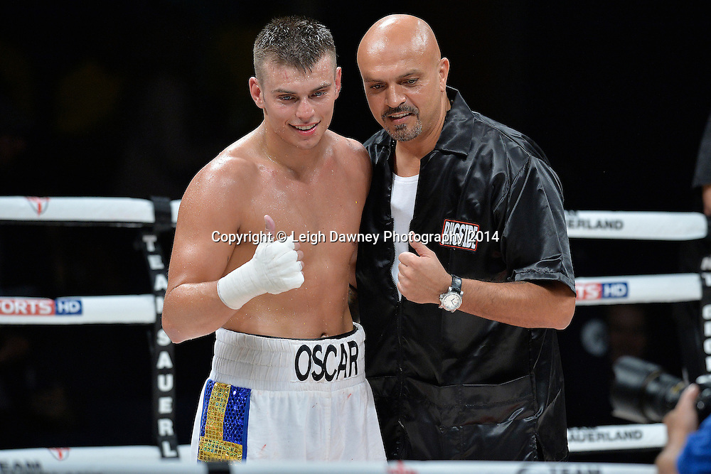 Oscar Ahlin (with trainer) defeats Olegs Fedotovs in a Light Heavyweight contest at the SSE Wembley Arena, London on the 20th September 2014. Sauerland Promotions. Credit: Leigh Dawney Photography.