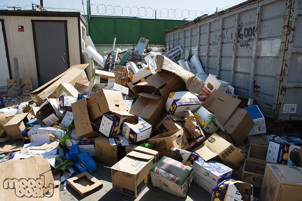 Pile of cardboard boxes in recycling centre