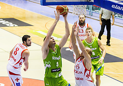 Uros Slokar of Slovenia vs Beka Tsivtsivadze of Georgia during friendly basketball match between National teams of Slovenia and Georgia in day 2 of Adecco Cup 2014, on July 25, 2014 in Dvorana OS 1, Murska Sobota, Slovenia. Photo by Vid Ponikvar / Sportida.com