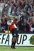 Photo: Gerrit de Heus. Rotterdam. UEFA Cup Final. Feyenoord-Borussia Dortmund. Pierre van Hooijdonk drinks from the Cup. Keywords: beker
