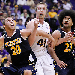 December 15, 2011; Baton Rouge, LA; UC Irvine Anteaters forward Adam Folker (20) and guard Michael Wilder (23) box out LSU Tigers center Justin Hamilton (41) during the second half of a game at the Pete Maravich Assembly Center. LSU defeated UC Irvine 66-59.  Mandatory Credit: Derick E. Hingle-US PRESSWIRE