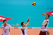 (C) Fabian Drzyzga and (R) Piotr Nowakowski both from Poland during the 2013 CEV VELUX Volleyball European Championship match between Poland v Slovakia at Ergo Arena in Gdansk on September 22, 2013.<br /> <br /> Poland, Gdansk, September 22, 2013<br /> <br /> Picture also available in RAW (NEF) or TIFF format on special request.<br /> <br /> For editorial use only. Any commercial or promotional use requires permission.<br /> <br /> Mandatory credit:<br /> Photo by &copy; Adam Nurkiewicz / Mediasport