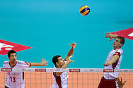 (C) Fabian Drzyzga and (R) Piotr Nowakowski both from Poland during the 2013 CEV VELUX Volleyball European Championship match between Poland v Slovakia at Ergo Arena in Gdansk on September 22, 2013.<br /> <br /> Poland, Gdansk, September 22, 2013<br /> <br /> Picture also available in RAW (NEF) or TIFF format on special request.<br /> <br /> For editorial use only. Any commercial or promotional use requires permission.<br /> <br /> Mandatory credit:<br /> Photo by © Adam Nurkiewicz / Mediasport