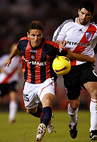 RIVER PLATE (2) Vs. SAN LORENZO de Almadro (2) for the soccer match in the Copa Libertadores at River Plate Stadium.<br /> SAN LORENZO move to next round after classification in a (4-3 aggregate)<br /> Buenos Aires, Argentina May 8, 2008.<br /> SAN LORENZO player GONZALO BERGESSIO and River Plate EDUARDO TUZZIO<br /> © Gabriel Piko / PikoPress