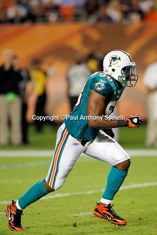 Miami Dolphins linebacker Karlos Dansby (58) chases the action during the NFL week 11 football game against the Chicago Bears on Thursday, November 18, 2010 in Miami Gardens, Florida. The Bears won the game 16-0. (©Paul Anthony Spinelli)