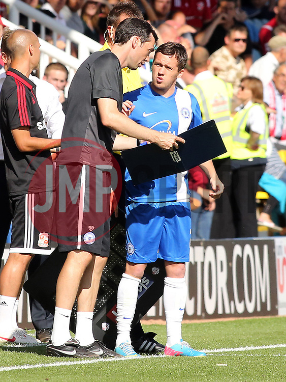 Peterborough United's Danny Swanson receives instructions from Peterborough United's first team coach Gary Breen - Photo mandatory by-line: Joe Dent/JMP - Tel: Mobile: 07966 386802 03/08/2013 - SPORT - FOOTBALL -  London Road Stadium - Peterborough -  Peterborough United v Swindon Town - Sky Bet One