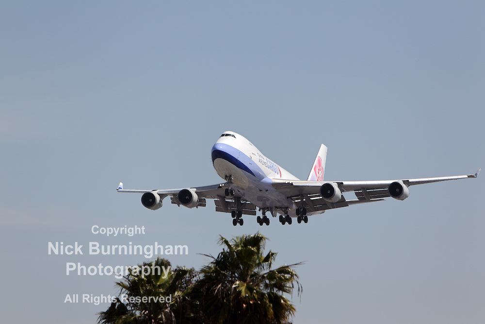 LOS ANGELES, CALIFORNIA, USA - MARCH 21, 2013 - China Airlines Cargo Boeing 747-409F lands at Los Angeles Airport on March 21, 2013. The plane has a range of 8,230 km at 564 mph