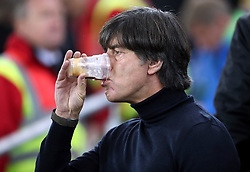 Germany manager Joachim Low has a drink before the 2018 FIFA World Cup Qualifying, Group C match at Windsor Park, Belfast.