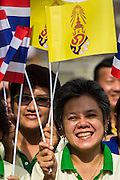 "01 AUGUST 2013 - BANGKOK, THAILAND: Thais wave the yellow flag of the Thai monarchy while they chant ""Long Live the King"" at Siriraj Hospital before Bhumibol Adulyadej, the King of Thailand, 85, was discharged from Bangkok's Siriraj Hospital, Thursday where he has lived since September 2009. He traveled to his residence in the seaside town of Hua Hin, about two hours drive south of Bangkok, with his wife, 80-year-old Queen Sirikit, who has also been treated in the hospital for a year.      PHOTO BY JACK KURTZ"