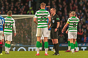 Match Referee William Collum has a word with Kristoffer Ajer of Celtic FC during the Betfred Scottish League Cup Final match between Rangers and Celtic at Hampden Park, Glasgow, United Kingdom on 8 December 2019.