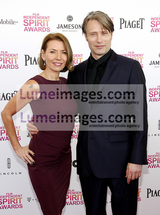 Mads Mikkelsen and Hanne Jacobsen at the 2013 Film Independent Spirit Awards held at the Santa Monica Beach in Los Angeles, United States, 230213.