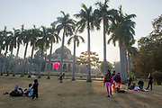 Children and families play in front of  the tomb of Muhammad Shah in Lodi Gardens in New Delhi, India.