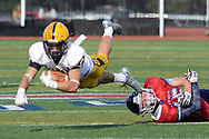 Central Bucks West's Ryan Moylan (11) dives for additional yardage as Central Bucks East's Ty Tracy (45) lies behind him in the third quarter Saturday, October 21, 2017 at Central Bucks East in Buckingham, Pennsylvania. (WILLIAM THOMAS CAIN / For The Philadelphia Inquirer)