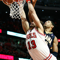 16 April 2011: Chicago Bulls center Joakim Noah (13) dunks the ball past Indiana Pacers small forward Danny Granger (33) during the Chicago Bulls 104-99 victory over the Indiana Pacers, during the game 1 of the Eastern Conference first round at the United Center, Chicago, Illinois, USA.