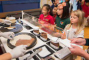 Students learn about the restaurant business from crepe maker Leslie Abrams-Schwartz during a session of Career Week at Poe Elementary School, December 5, 2013.